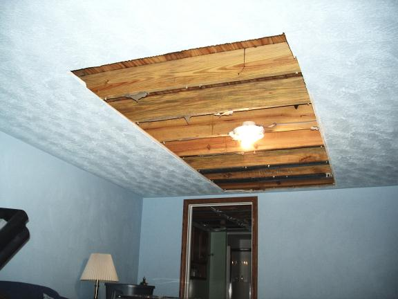 Ceiling with water damage being fixed